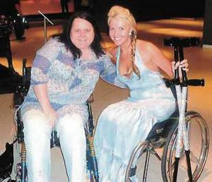 Debbie Deboo with Kelly-Marie Stewart and the crutches