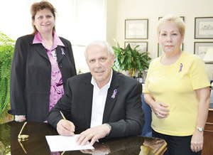 Denise Hurtubise (left), Carol Boileau (right) donned purple ribbons, and Mayor Bob Kilger
